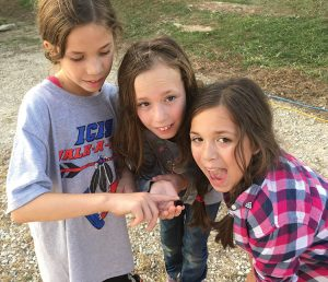 Kayle and her sisters observe a caterpillar. What will it become?